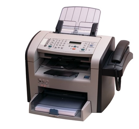 The modern multipurpose device: a fax, copier and the scanner. It is accurately isolated without shades on a white background. Studio work. photo