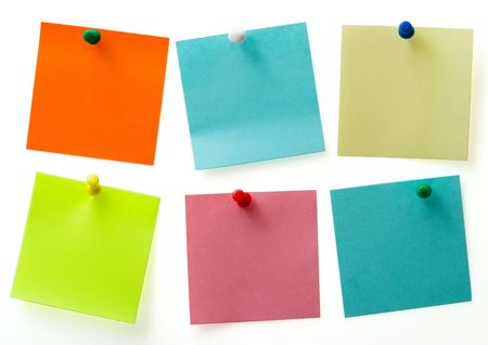 A different color post it notes with spins isolated with path. Studio light. Natural shade. Stock Photo