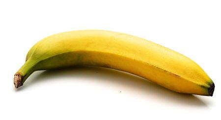 platano maduro: La banana madura aisladas sobre fondo blanco. Luz de sombra.