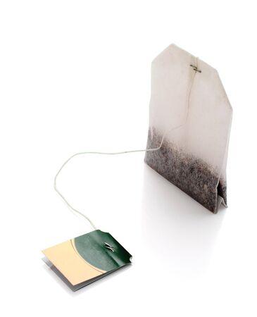 bolsita: Bolsa de t� aisladas sobre fondo blanco. Luz de sombra.