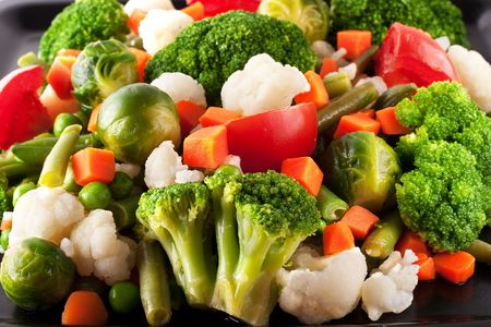 Vegetables: cauliflower, brussels sprouts, broccoli, carrots, string beans  and tomatoes photo