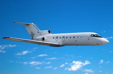 corporate jet: Airplane flying against the blue sky Stock Photo