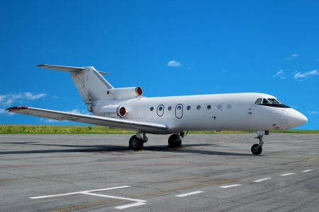 corporate jet: Airplane parked at airport. Small business jet.