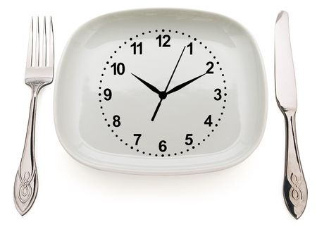 dishware: Dishware and clock. Concept restrictions in food
