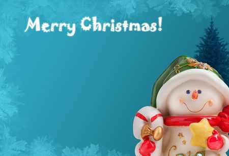 Christmas greeting card with a snowman, a xmas tree and ice frost photo