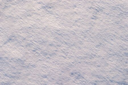 emphasizes: Texture of the snow. Thin snow crust on the surface of the frozen lake. Natural sunlight emphasizes texture. Pattern # 1 Stock Photo
