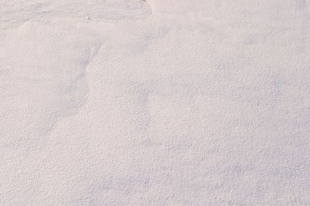 emphasizes: Texture of the snow. Thin snow crust on the surface of the frozen lake. Natural sunlight emphasizes texture. Pattern # 3 Stock Photo