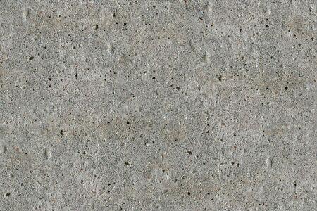 The texture of concrete. Uniform illumination. A typical rough uneven surface. Stock Photo