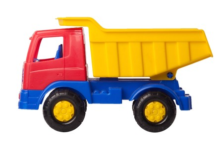 Toy truck is isolated on a white background, side view