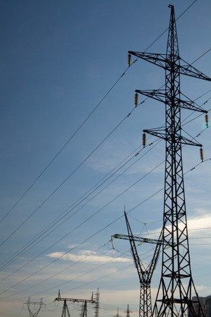 insulant: High-voltage power lines against the sky. Industrial background for appropriate purposes Stock Photo