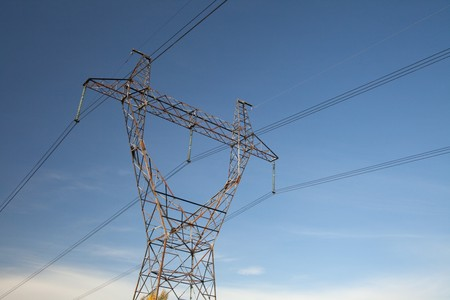 superconductor: High-voltage power lines against the sky. Industrial background for appropriate purposes Stock Photo