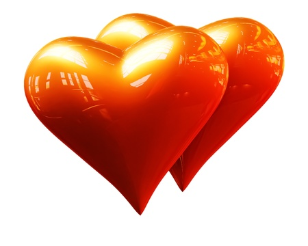 A pair of golden hearts on a white background photo