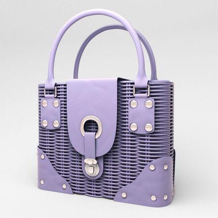 Women's lilac wicker handbag closeup on light background Stock Photo - 17476164