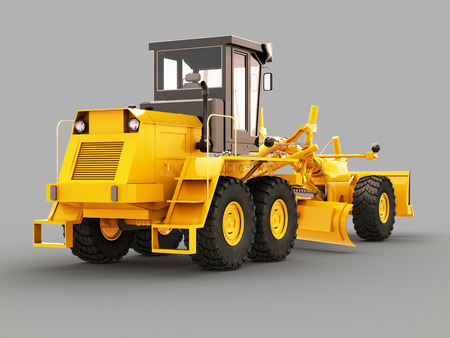 Modern three-axle road grader on a gray background photo