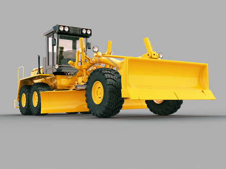 Modern three-axle road grader on a gray background Stock Photo