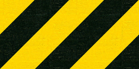 standstill: Warning black and yellow hazard stripes texture. Construction sign