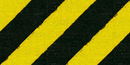 backstop: Warning black and yellow hazard stripes texture. Construction sign