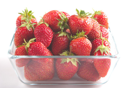 viands: Pile of ripe garden strawberries close-up Stock Photo