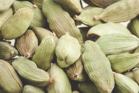 cardamum: Green cardamom pods close-up. Macro photo