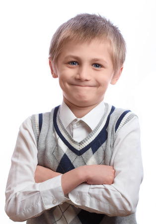 Blonde boy, 8 years old, isolated on a white background photo
