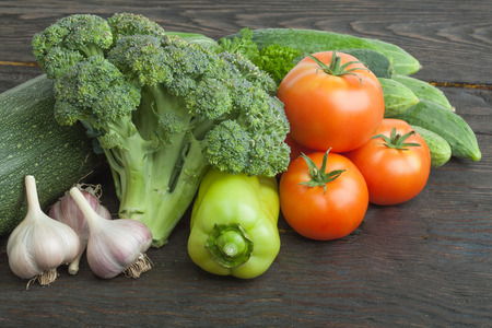 viands: Raw organic vegetables on the wooden table Stock Photo