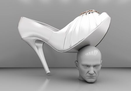 layman: The mans head under a female heel on a gray background