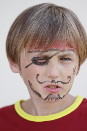 spite: A close-up portrait of a grumpy angry pirate boy Stock Photo