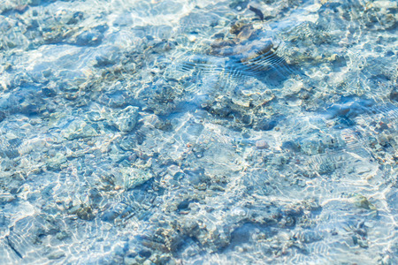 turqoise: Rocky sea floor and crystal clear turqoise water