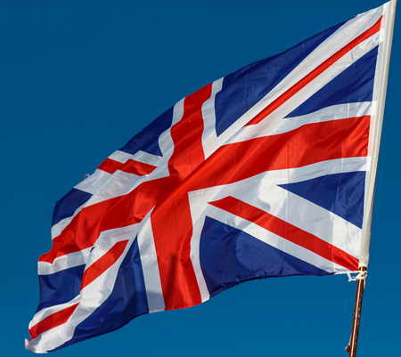 great britain: Great Britain Flag with wrinkles and seams expanded in the breeze Stock Photo