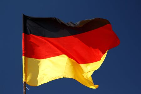 unfurl: Flag of Germany with wrinkles and seams expanded in the breeze Stock Photo