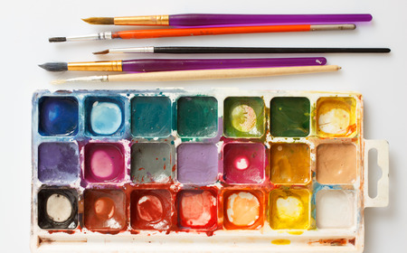 paintbox: Closeup of water-color paint-box and paint brushes
