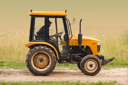 truck tractor: Farm tractor goes on road Stock Photo