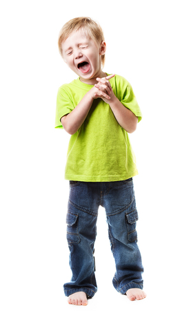 Close-up of portrait happy boy screaming  on white background Stock Photo