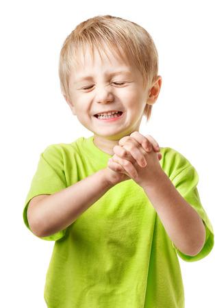 blinking: Happy blond boy blinking Stock Photo