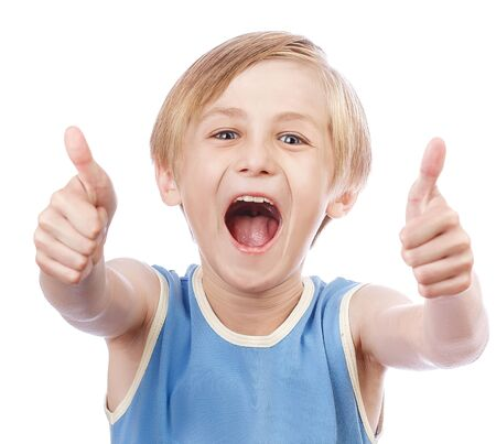 allright: Smiling young little boy giving thumb up gesture, isolated