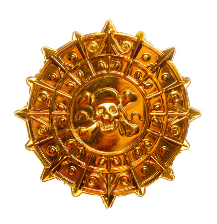 gold plaque: Gold medallion with skull and crossed bones isolated