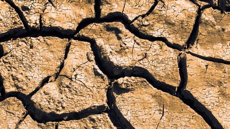 desertification: Dry cracked earth texture. Cracks in the dried soil in arid season. Desertification