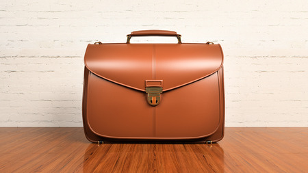 leather briefcase: Closeup of fashionable leather briefcase on hardwood table