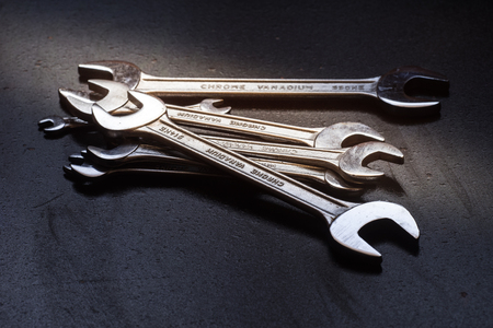 Set of the stainless steel wrench on dark background Stock Photo