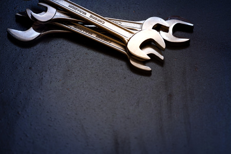 Set of the stainless steel wrench on dark background with space for text Stock Photo