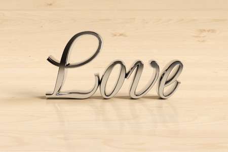 glans: Metal love sign on wood background