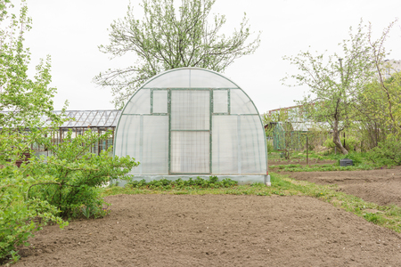 vents: A small greenhouse with air vents in the garden