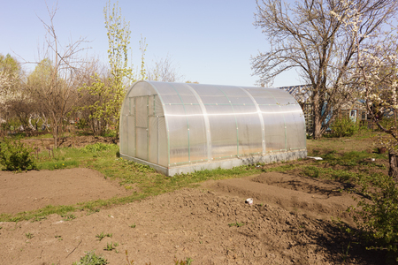incubation: A small greenhouse with air vents in the garden