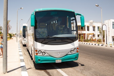 buss: EGYPT, SHARM EL SHEIKH - JULY 20, 2015: Sharm el-Sheikh is holiday resort and significant centre for tourism in Egypt. Big tourist buses on parking.