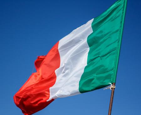 unfurl: Waving Flag Of Italy, Europe, Italian Republic. Italian Flag Blowing In The Wind. Italy Flag Of Silk On Blue Sky Background. Festa Della Repubblica Italiana. Italian National Day