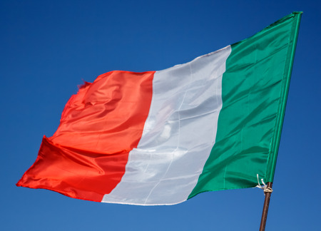 Waving Flag Of Italy, Europe, Italian Republic. Italian Flag Blowing In The Wind. Italy Flag Of Silk On Blue Sky Background. Festa Della Repubblica Italiana. Italian National Day