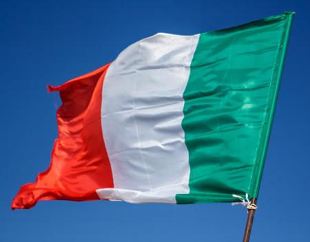 Waving Flag Of Italy, Europe, Italian Republic. Italian Flag Blowing In The Wind. Italy Flag Of Silk On Blue Sky Background. Festa Della Repubblica Italiana. Italian National Day