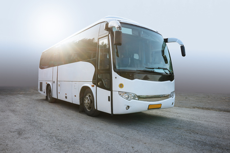 Modern White Passenger Bus on the Neutral Background, City Tourist Bus Transportation Vehicle,  Public Road Urban Travel Passenger Commercial City Bus. Modern and Comfortable Coach,  Traveling by Bus Stock Photo