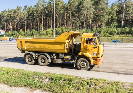asphalting: RUSSIA, YEKATERINBURG - AUGUST 19, 2016: A common Russian Kamaz dump truck at work