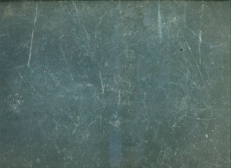 Heavily Scratched Gray Background, Dark Plastic Surface All in Scratches, for Texturing
